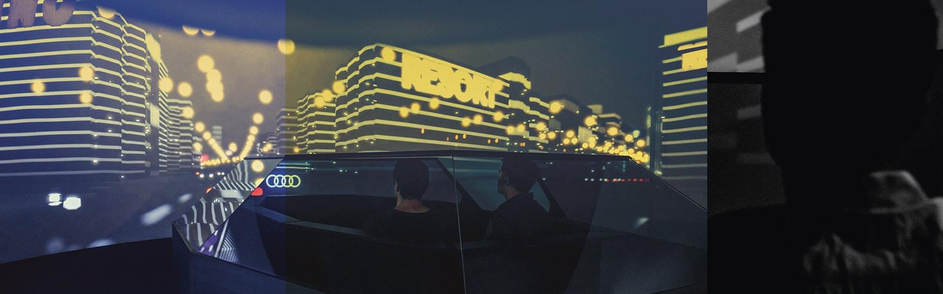 Futuristična slika notranjosti Audi avtomobila. V ozadju mesto in osvetljene zgradbe
